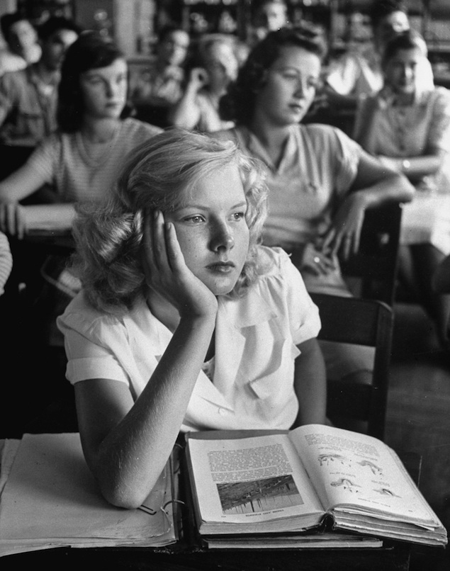 A girl daydreaming during class, Florida -- photo by Allan Grant, 1947